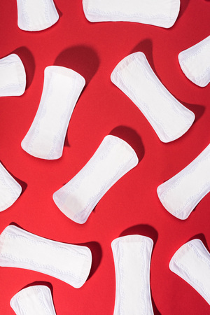 top view of collection of daily liners on red