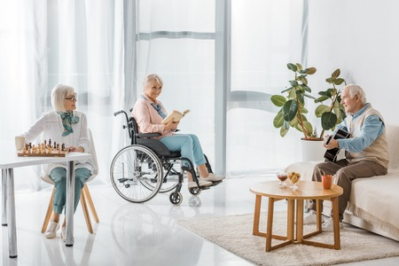 senior people spending time together in nursing home Standard-Bild