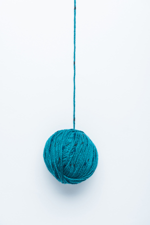 top view of blue yarn ball for knitiing on white backdrop Stok Fotoğraf - 111743265