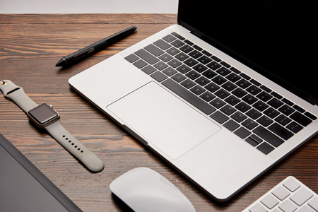 close-up shot of graphic designer gadgets on wooden table Stock Photo
