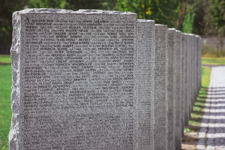 Close up view of old memorial gravestones with lettering at cemetery