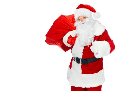 happy santa claus with christmas bag showing thumb up isolated on white