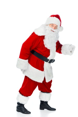 Bearded Santa Claus walking in red costume isolated on white Imagens - 112274368