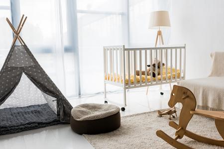 modern interior design of nursery room with bean bag chair