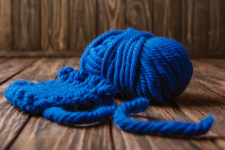 Close up view of blue yarn for knitting on wooden surface Stock fotó