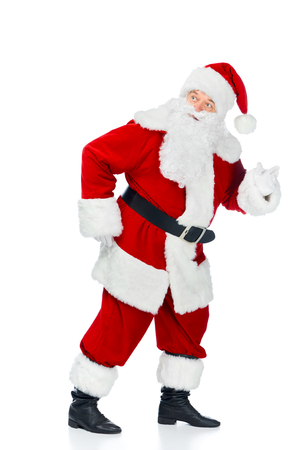 Funny Santa Claus walking in red costume isolated on white