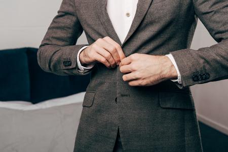 Cropped image of businessman buttoning up jacket Stock Photo