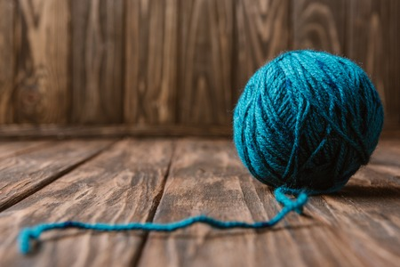 Close up view of blue yarn clew on wooden tabletop Stok Fotoğraf
