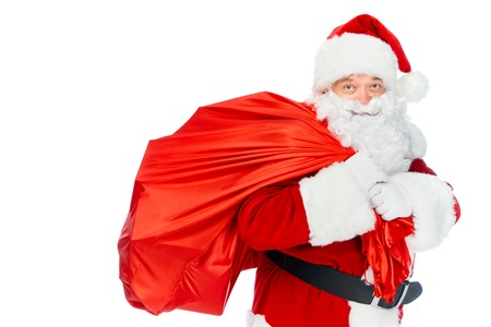 Santa Claus carrying red bag at Christmas time isolated on white