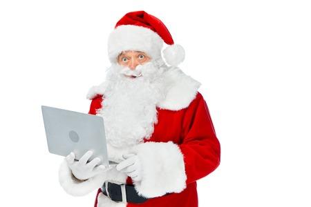 Bearded Santa Claus using laptop isolated on white