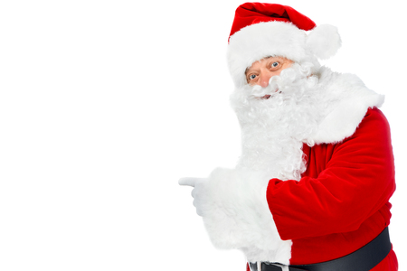 bearded santa claus pointing at something isolated on white 스톡 콘텐츠