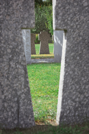 selective focus of memorial stone crosses placed in row at cemetery Stockfoto