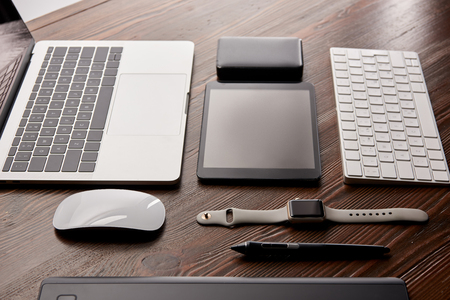 Assembled various modern gadgets on wooden table Stock Photo