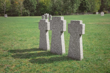 old memorial stone crosses placed in row at graveyard Zdjęcie Seryjne - 111784912