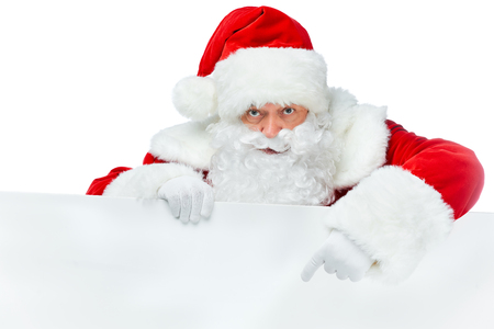 bearded santa claus pointing at blank board isolated on white Stock Photo