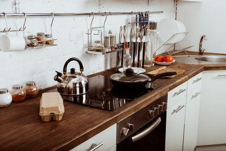 modern kitchen interior with frying pan and teapot on stove Stock fotó