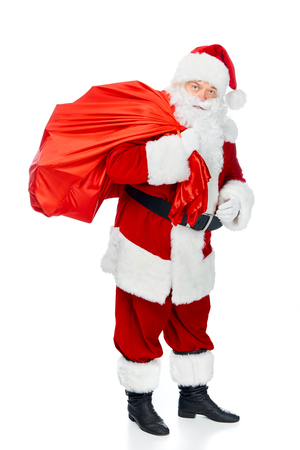 santa claus in red costume carrying christmas bag isolated on white 免版税图像