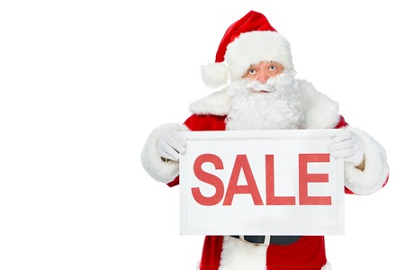 santa claus holding sale board isolated on white