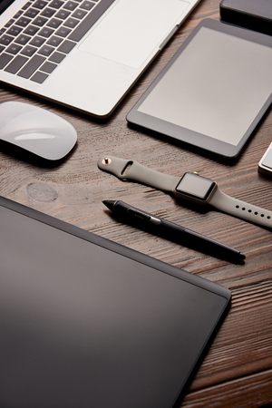 close-up shot of different modern gadgets on retoucher workplace
