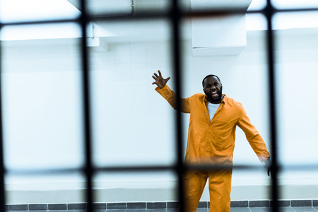 african american prisoner screaming in prison cell