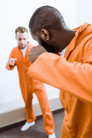 Multiethnic prisoners fighting in prison cell