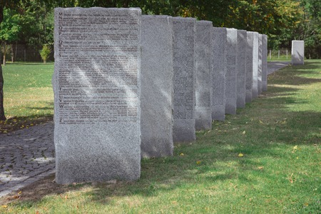 Old memorial gravestones with lettering at cemetery Stockfoto