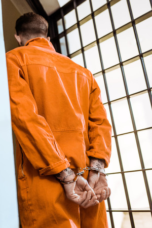 bottom view of prisoner standing in handcuffs Banco de Imagens