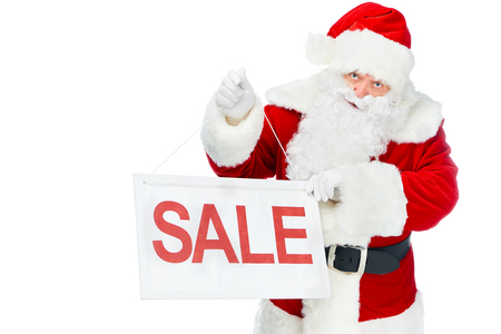 santa claus holding discount board with sale sign isolated on white