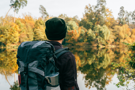 male traveller with backpack on autumnal background Banco de Imagens