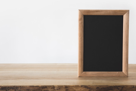 one empty blackboard on wooden table on white 스톡 콘텐츠