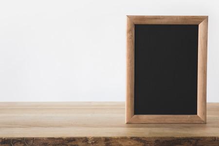 one empty blackboard on wooden table on white Stock Photo
