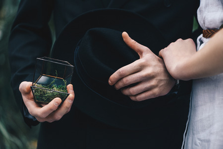 cropped shot of young couple standing together and man holding jewelry box with engagement ring Stock Photo