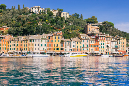 buildings on coast and yachts in sea bay in Portovenere, Italy 免版税图像