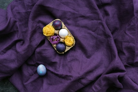 Egg carton with chicken eggs and flowers on textile background Stok Fotoğraf