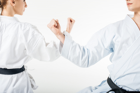 cropped image of karate fighters showing block with hands isolated on white Stock Photo
