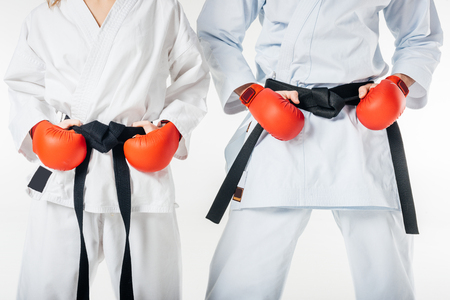 cropped image of karate fighters with black belts and red gloves isolated on white Banco de Imagens - 111817438