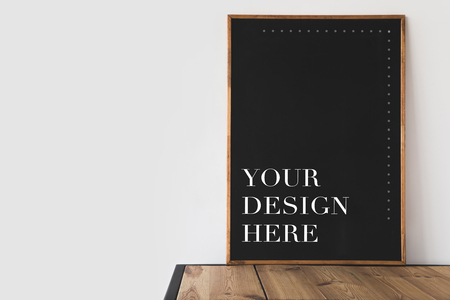 big blackboard with text your design here on wooden table on white Stock Photo