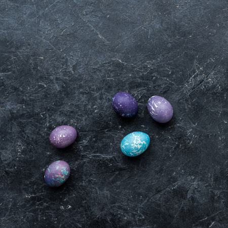 Colorful Easter eggs on dark background 스톡 콘텐츠