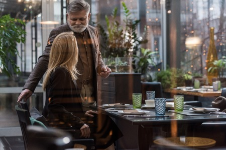 selective focus of senior man and woman on romantic date in restaurant Stock Photo