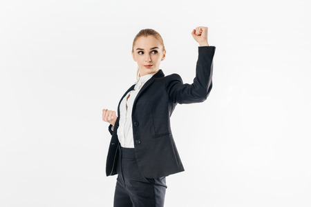 businesswoman standing in karate position in suit isolated on white 写真素材