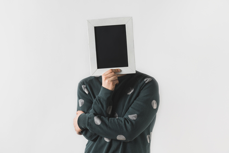 man covering face with black board isolated on white Stock fotó