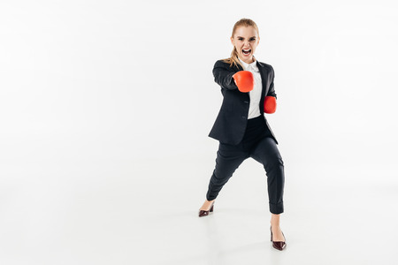 businesswoman screaming in suit and red gloves isolated on white Foto de archivo - 111818668