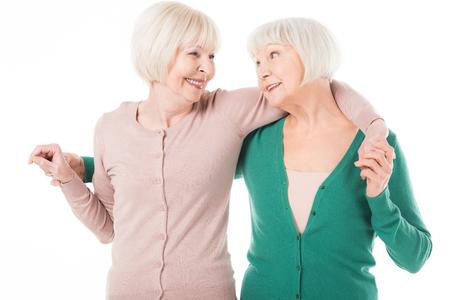 Two senior stylish women embracing isolated on white Reklamní fotografie