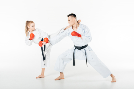 young karate fighters training with red gloves isolated on white