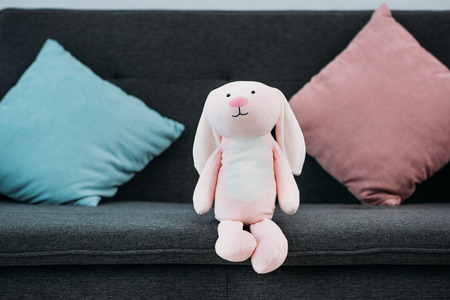 close up view of pink childish toy on sofa 写真素材 - 111843905