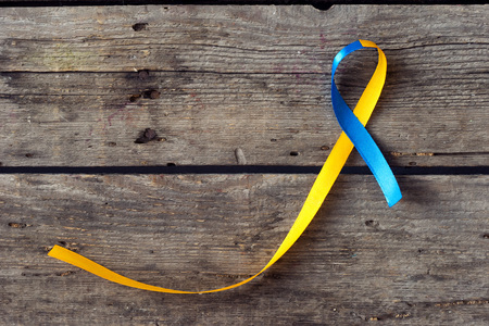 Down Syndrome Day blue and yellow ribbon on wooden background Stock fotó