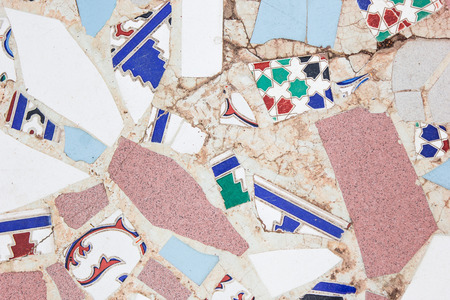 Wall with broken ceramic colored fragments