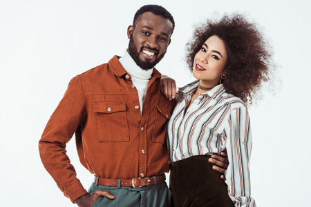 happy african american retro styled couple looking at camera isolated on white