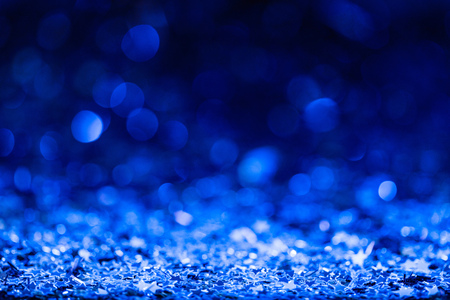 christmas background with blue blurred shiny confetti stars Stock Photo