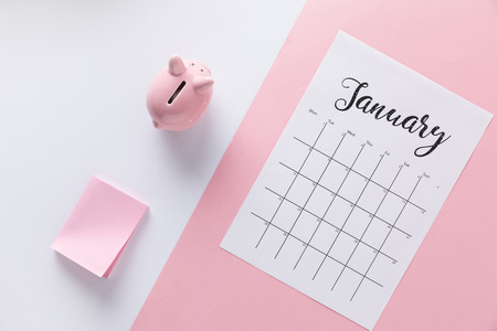 top view of arranged calendar, piggy bank and empty sticky notes Stockfoto - 111847711